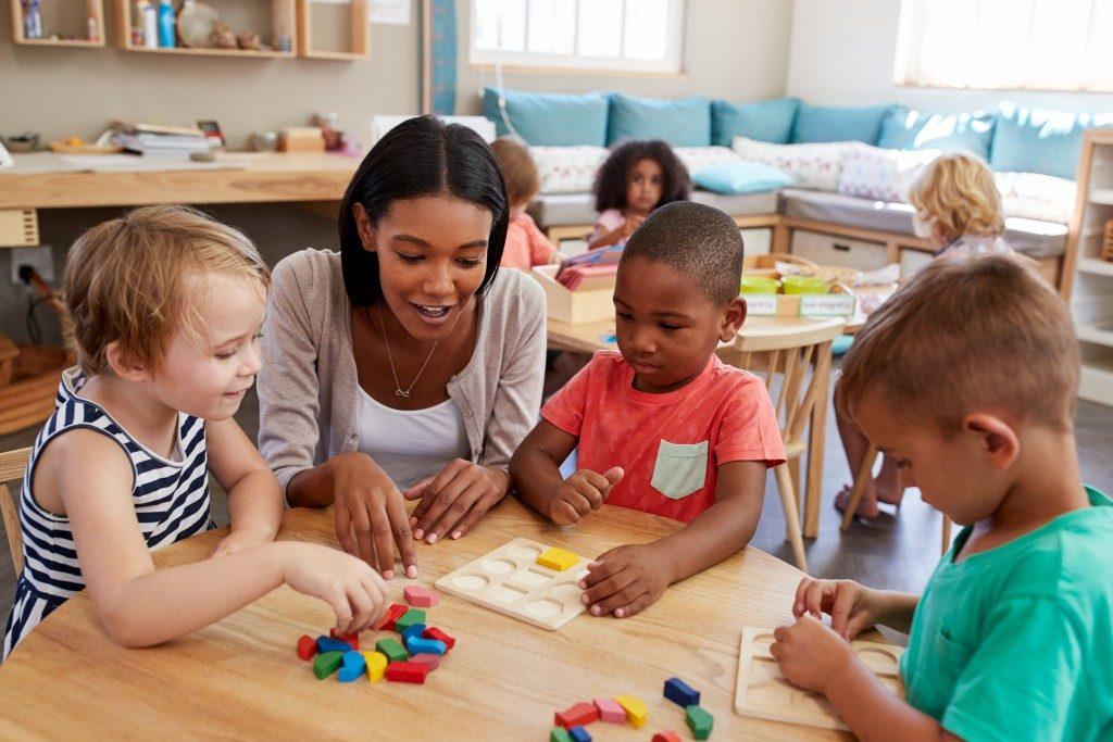 preschool teacher in her art class