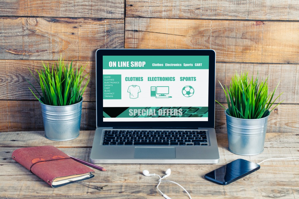 On line shop website template design on a laptop
