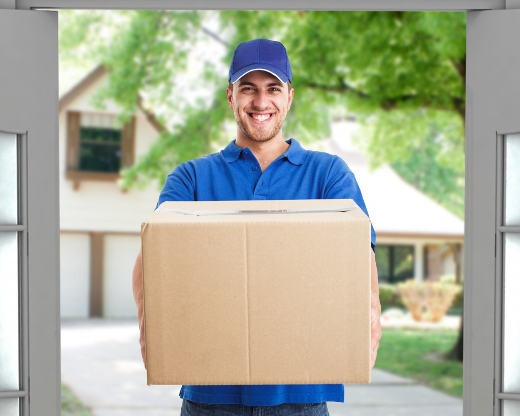 Delivery man handing the package