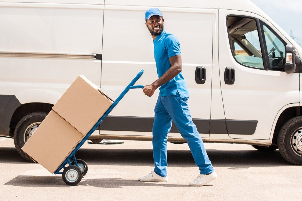 Delivery man handling packages