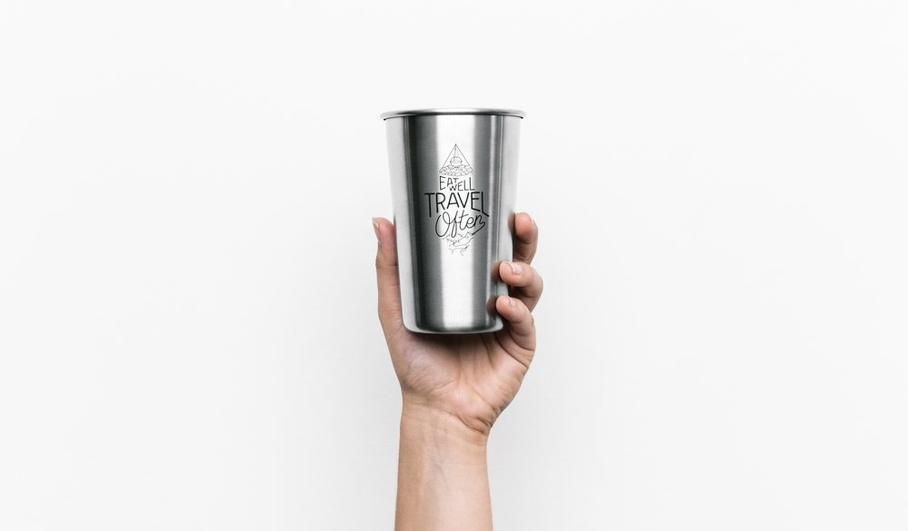 person holding a cup