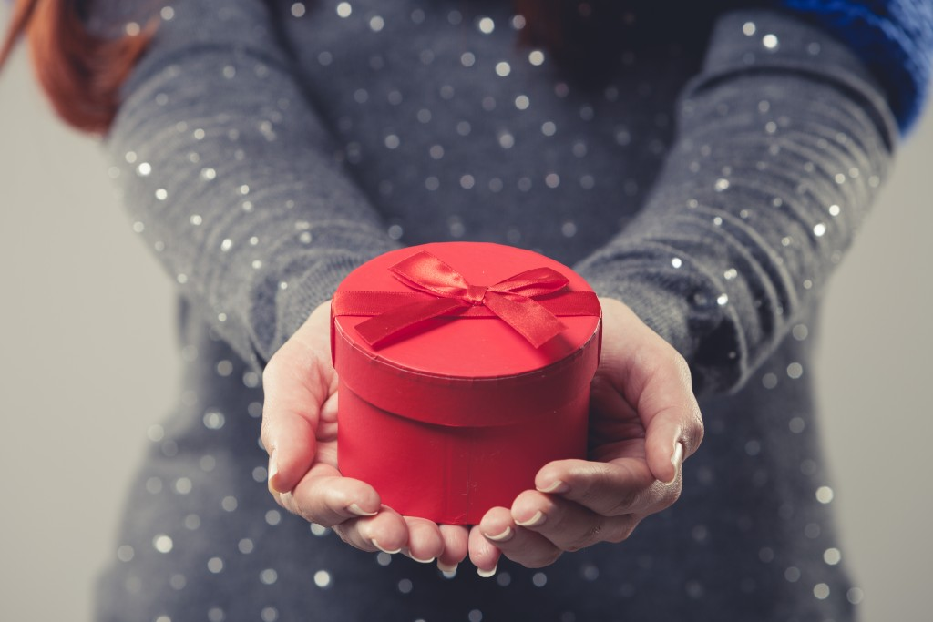Female holding a red gift box