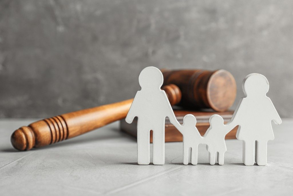 family cut outs with judge gavel on the background