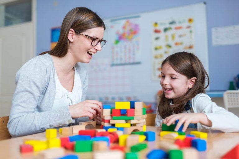 babysitter teaching kid