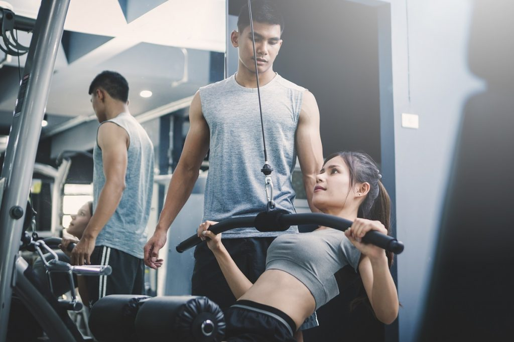 woman trained by her gym instructor
