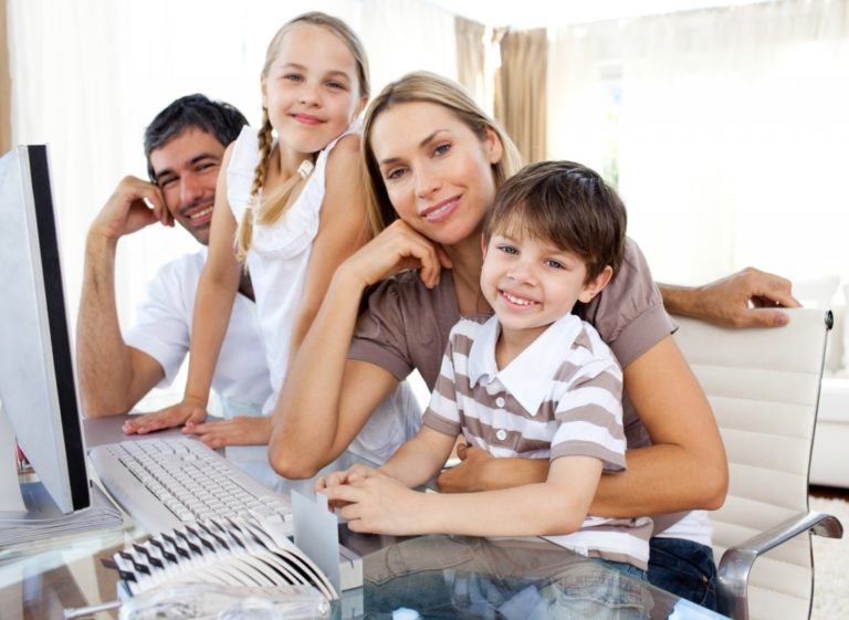 family with their children, ready for online school