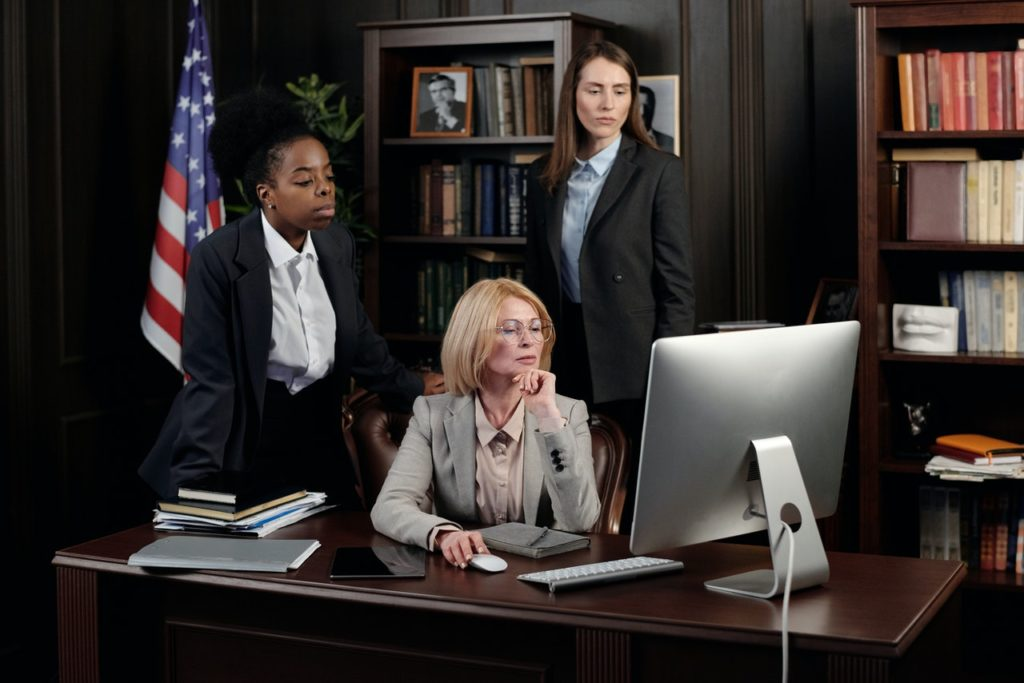 lawyers looking at a computer