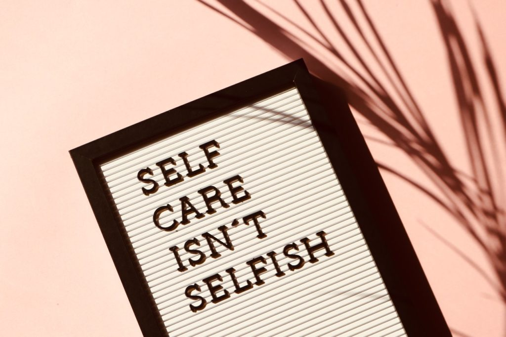 sign that reads self care isn't selfish