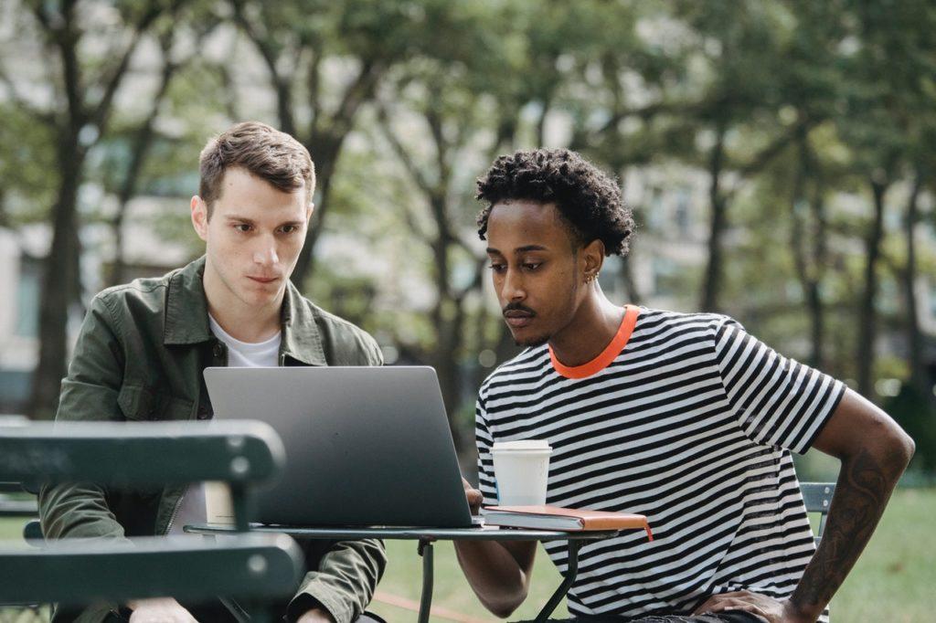 two men browsing the internet