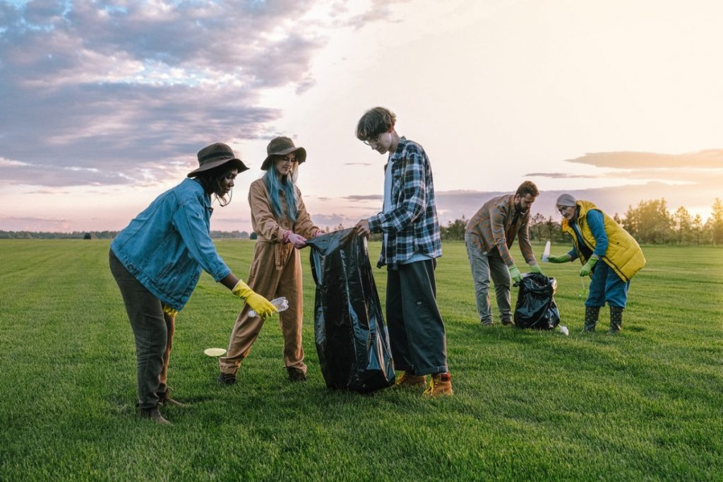 volunteers cleaning a field