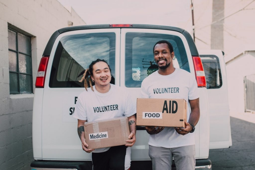 volunteers holding boxes