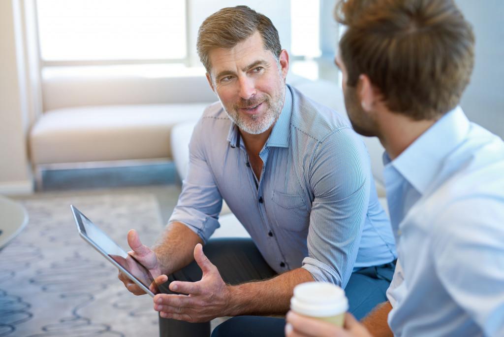 men having a conversation