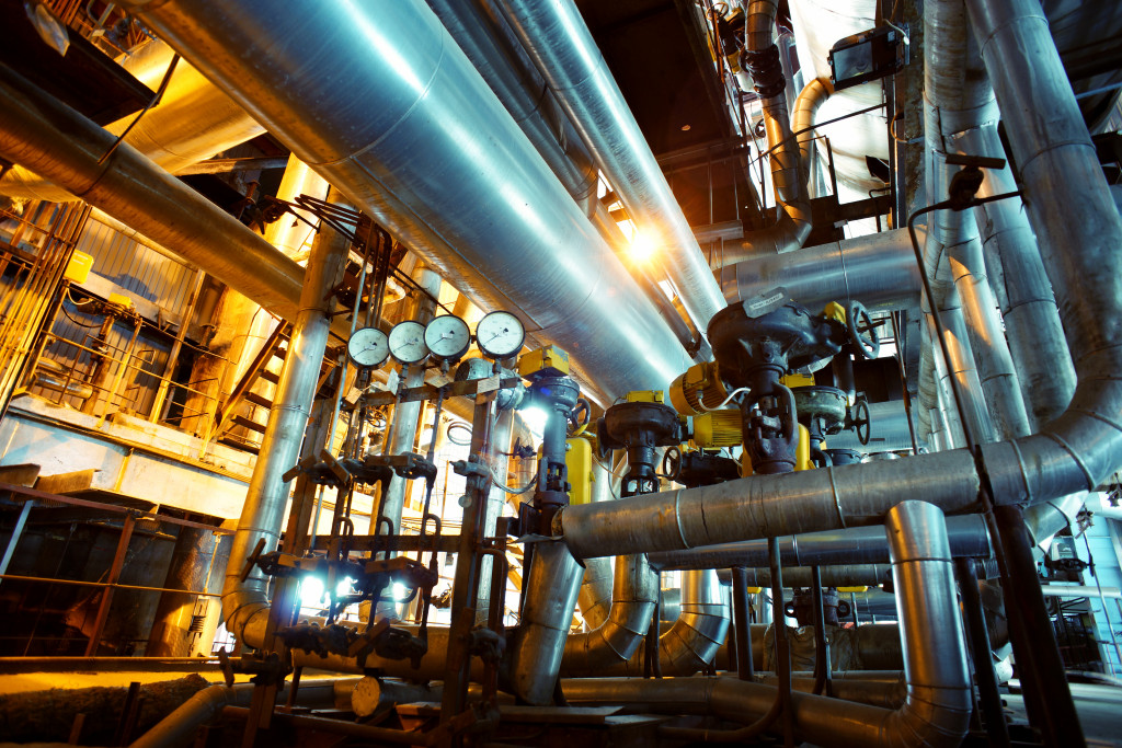 a picture of a factory and metal pipes